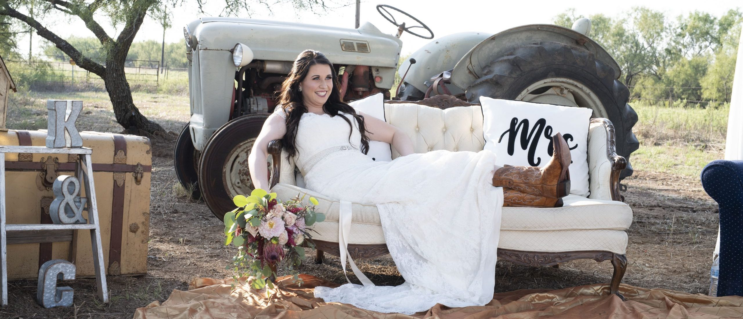 bride sitting on couch in wedding dress rustic hart ranch